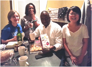 Edwin receives his gifts of chocolate and coffee. From left to right: Joanne Lisosky, Princess Reese, Edwin Tijramba, Shunying Wang. Photo Credit: Andrea Capere